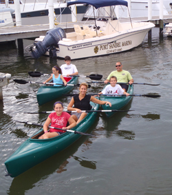 Family renting kayaks at Port Sanibel Marina, Fort Myers, Florida