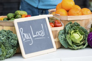 buy local sign at a farmer's market