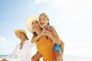 Three generations of mothers on the beach for Mother's Day