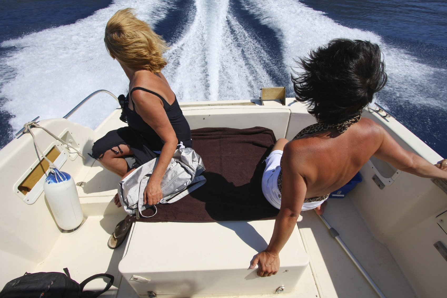 women on a boat rental