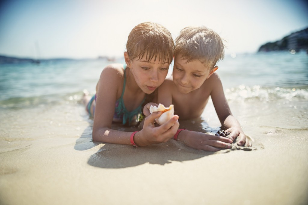 boy and girl inspecting shells
